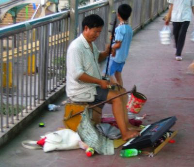A random picture of a talented begger/busker in ShenZhen from journeys through China.  Unlike most street beggers in China, this guy deserved every yuan he got.